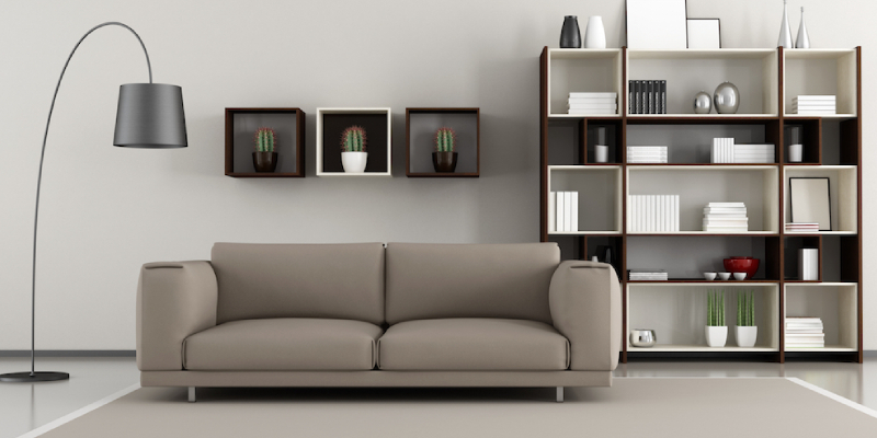 Living room decoration - Neatly aligned book shelf and lamps on the wall