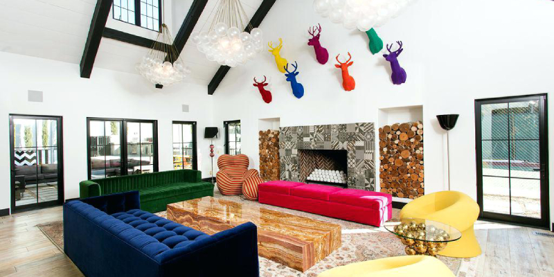 Living room decorated with colorful crafts on the wall and having colorful furnitures