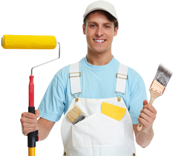 A smiling painter holding paint brush and paint roller in hands